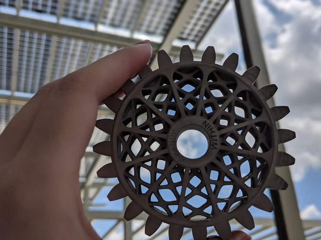A Metal Jet 3D printed part soaks up the sun under the Center of Excellence's photovoltaic roof [Image: Sarah Goehrke]