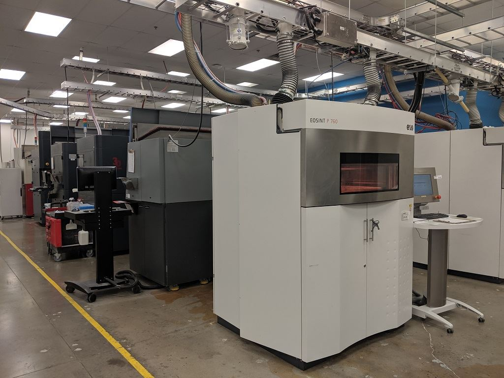 SLS 3D printers at work at Stratasys Direct Manufacturing in Belton, TX [Image: Fabbaloo]