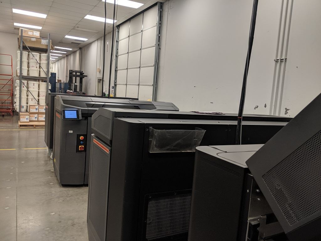 HP Jet Fusion 3D printers at work at Stratasys Direct Manufacturing in Belton, TX [Image: Fabbaloo]