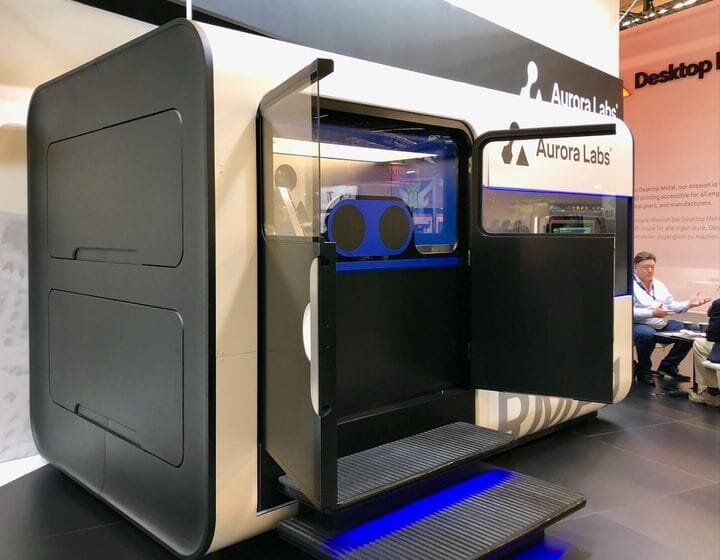 The Aurora Labs RMP1 Metal 3D printer, with CEO David Budge in the background [Source: Fabbaloo]