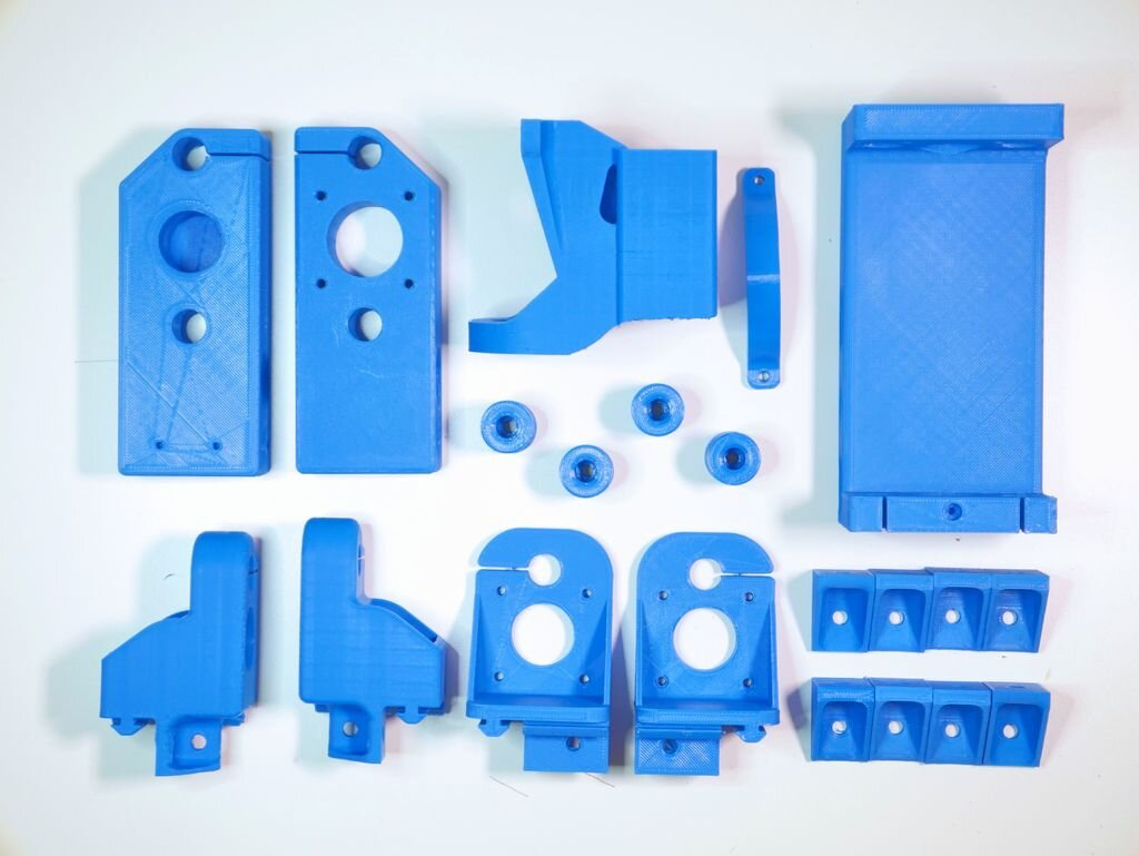 The 3D printed parts for the Dremel CNC [Source: Instructables]