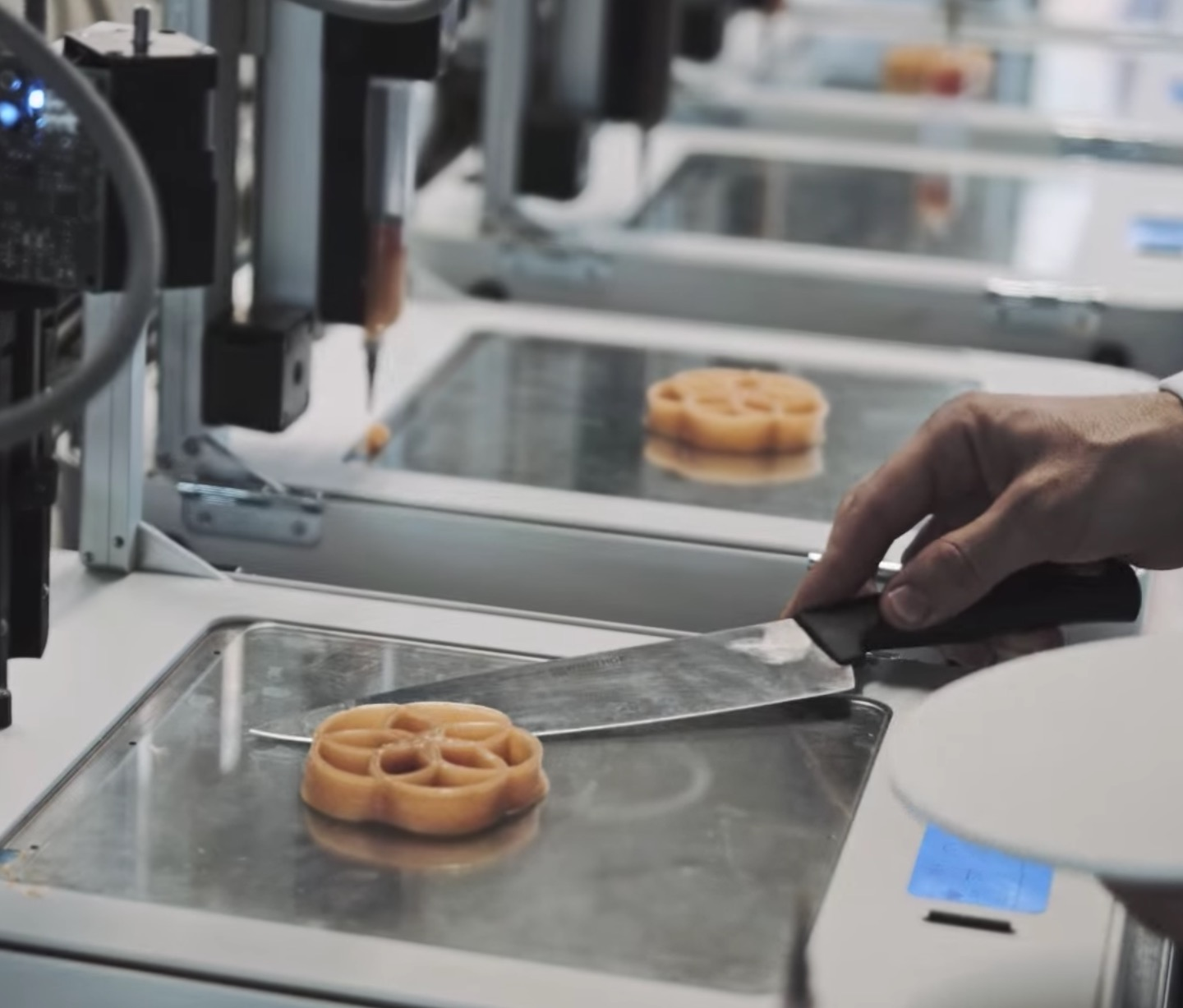 Removing a 3D printed food item from the machine