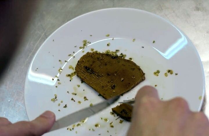 Dining on a 3D printed vegetarian steak. Try not to see the layer lines [Source: Nova Meat]