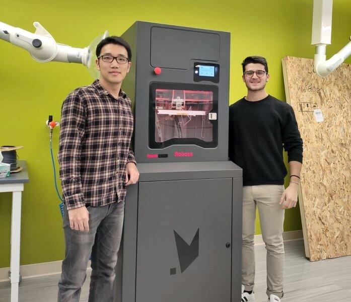 Penn State researchers beside their new high temperature 3D printer [Source: ROBOZE]