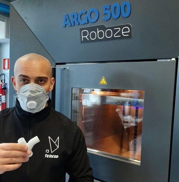 Roboze CEO Alessio Lorusso with 3D printed parts [Source: Roboze]