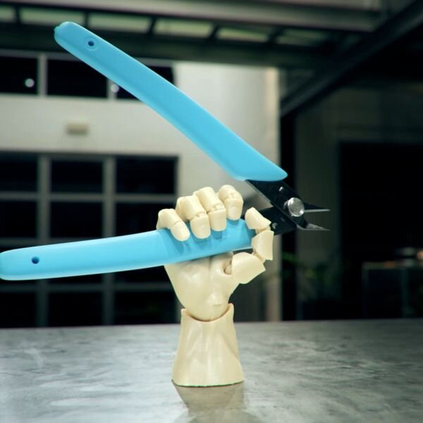 3D printed Articulated Poseable Hand holding a pair of snips [Source: MyMiniFactory]