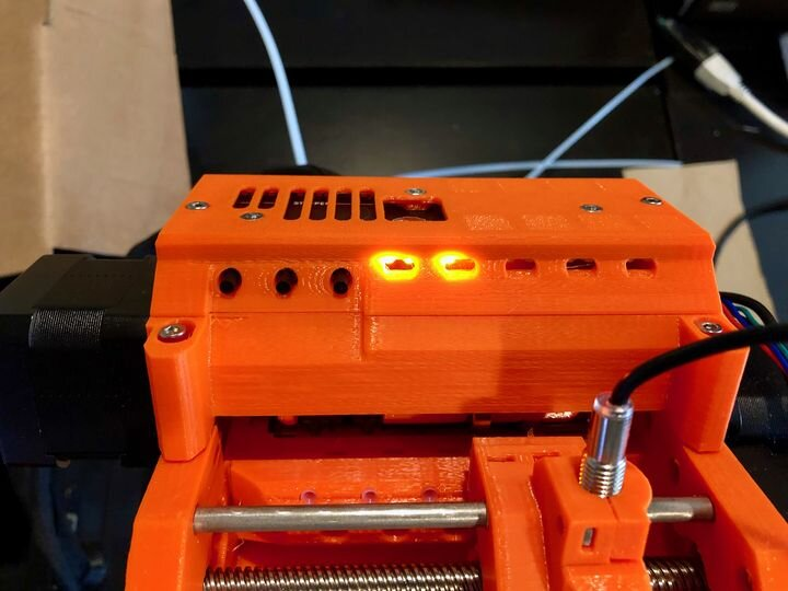 Three control buttons on the left of the Prusa MMU2S multi-material unit [Source: Fabbaloo]