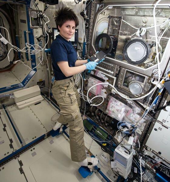 ESA astronaut Samantha Cristoforetti using the ISS 3D Printer [Source: NASA]