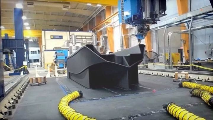 A full-size 3D printed boat being printed [Source: SolidSmack]