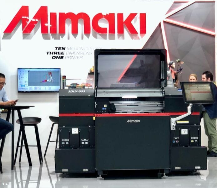 Mimaki displaying one of their powerful full-color 3D printers [Source: Fabbaloo]