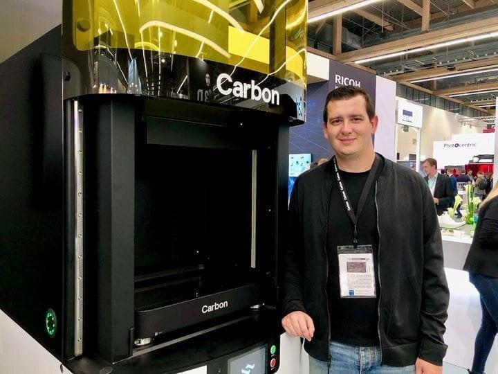 Carbon's Philip DeSimone beside the Carbon L1 3D printer [Source: Fabbaloo]