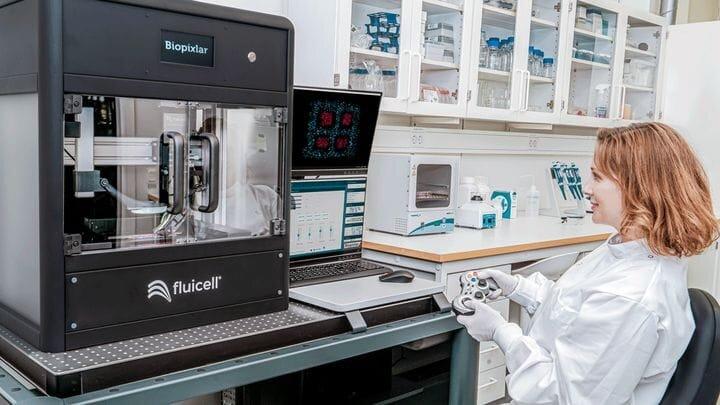 Tech operates the Biopixlar bioprinter [Source: Fluicell]