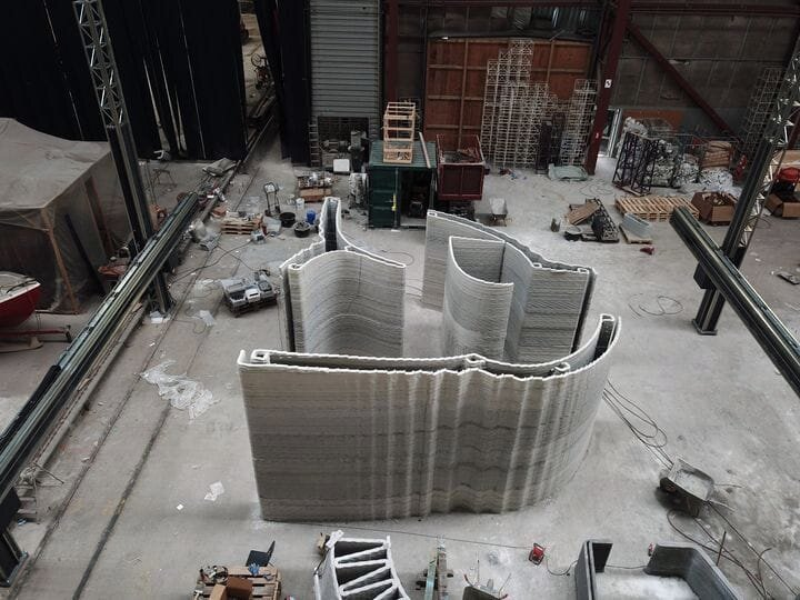 The COBOD BOD2 construction 3D printer at work on a large, complex wall section [Source:COBOD]