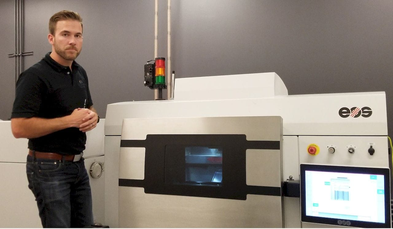 Matthew Gale showing a real-time sensor installed on an EOS metal 3D printer [Source: Polysense Solutions]