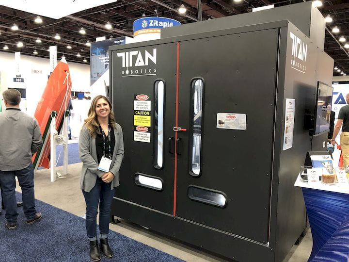 A large-format 3D printer from Titan Robotics, with co-Founder Maddie Guillory for scale [Source: Fabbaloo]