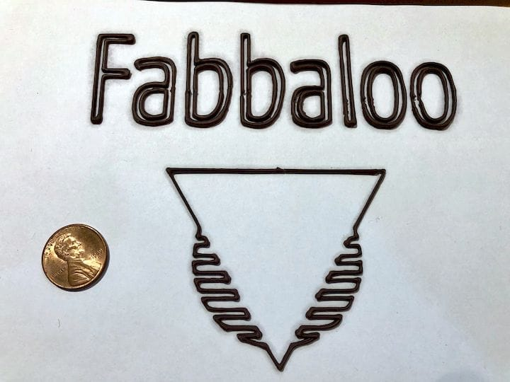 A chocolate 3D print made by a typical chocolate 3D printer: very low to the ground [Source: Fabbaloo]