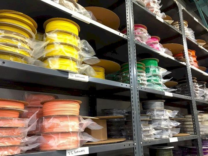 Stacks of 3D printer filament at a thermoplastics manufacturer [Source: Fabbaloo]