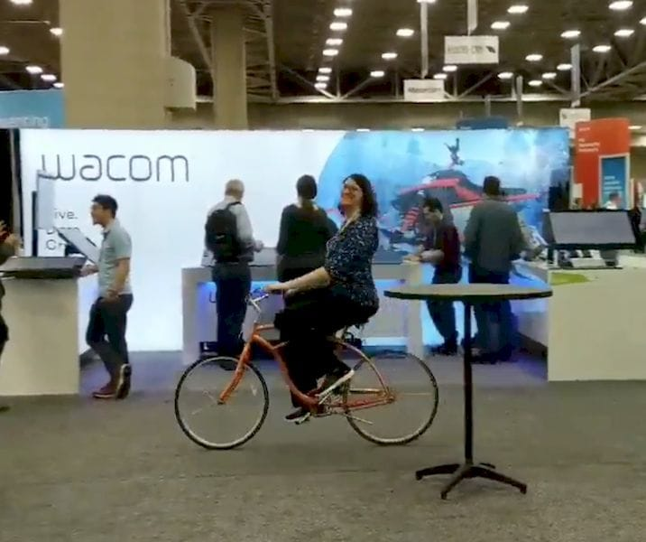 Yes, that is our very own Sarah Goehrke riding a bicycle (with 3D printed airless tires, of course) around SWW2019 [Source: Fabbaloo]