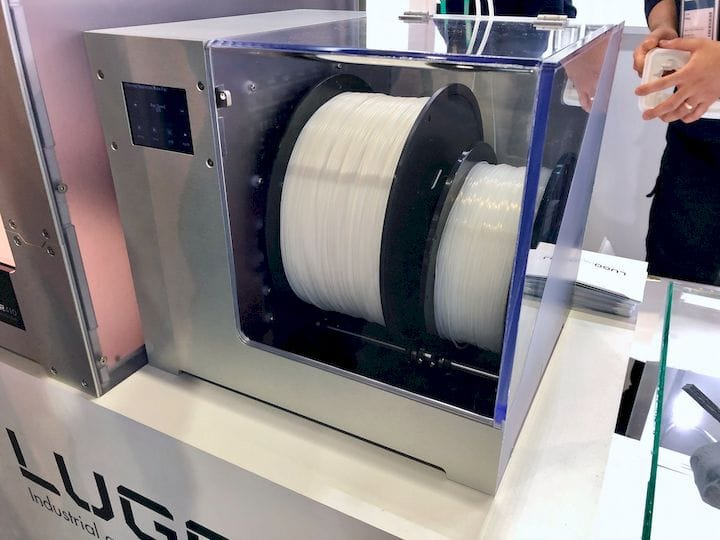 A filament dry box attached to a Lugo Labs 3D printer [Source: Fabbaloo]