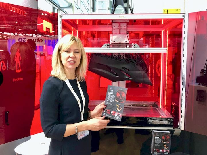 Photocentric's Sally Tipping showing the true size of their new LC Maximus resin 3D printer [Source: Fabbaloo]