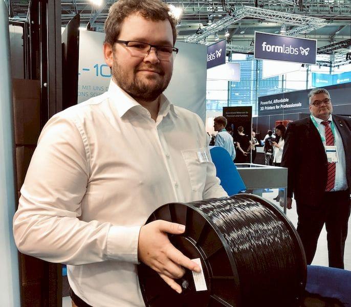 EVO-TECH's Markus Kaltenbrunner holding a heavy 10kg spool of 3D printer filament [Source: Fabbaloo]