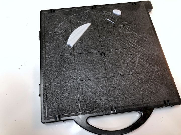 A used uPrint tray, showing marks where rafts once held [Source: Fabbaloo]