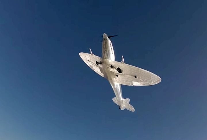A ghostly 3D printed Spitfire flies in the sky [Source: Flite Test]