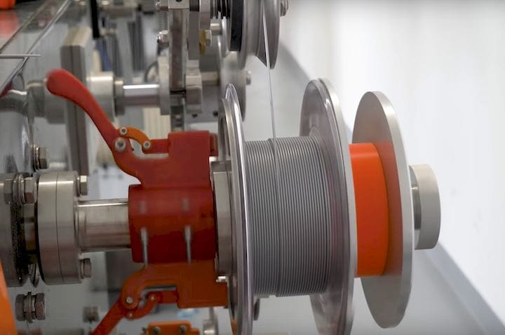 A robotic winding system ensures tidy spools [Source: Prusa Research]