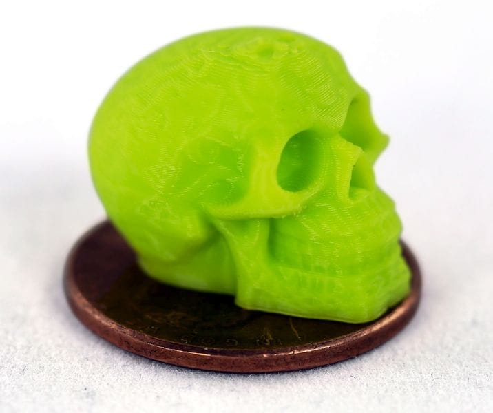 Yes, that's a penny! A new extruder from Aleph Objects printed this very tiny object [Source: Aleph Objects]