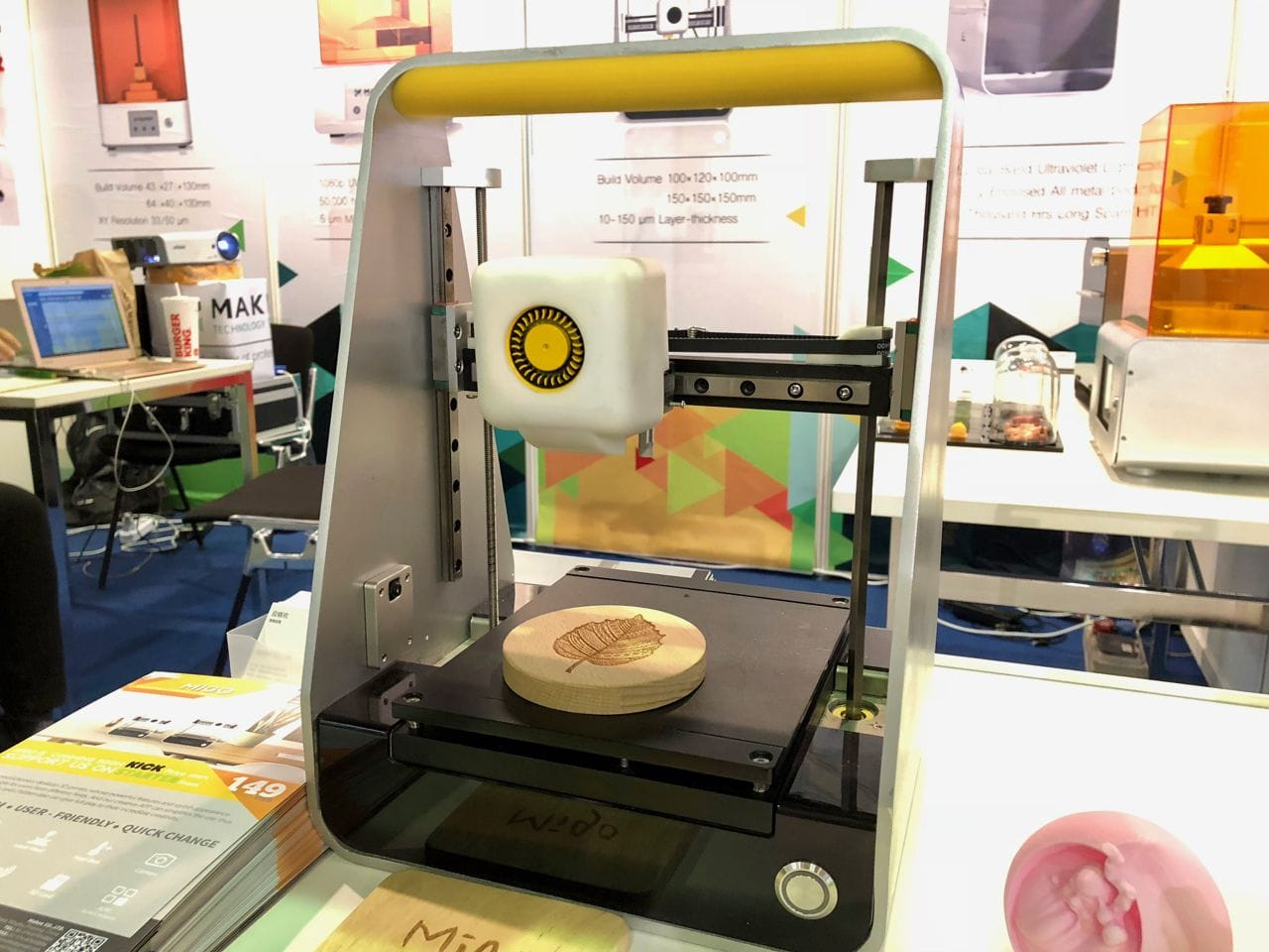 The MakeX Migo L portable desktop 3D printer, showing a laser engraved wood piece