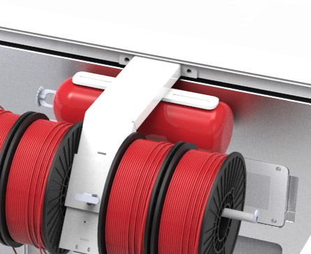 The 3DPrintClean's fire suppression system tucked in behind these 3D printer filament spools