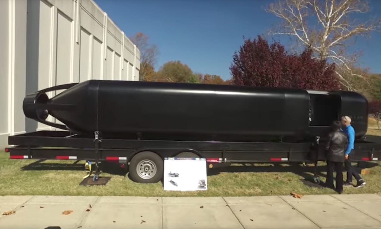 The 3D printed submarine hull from the US Navy, with some humans for scale