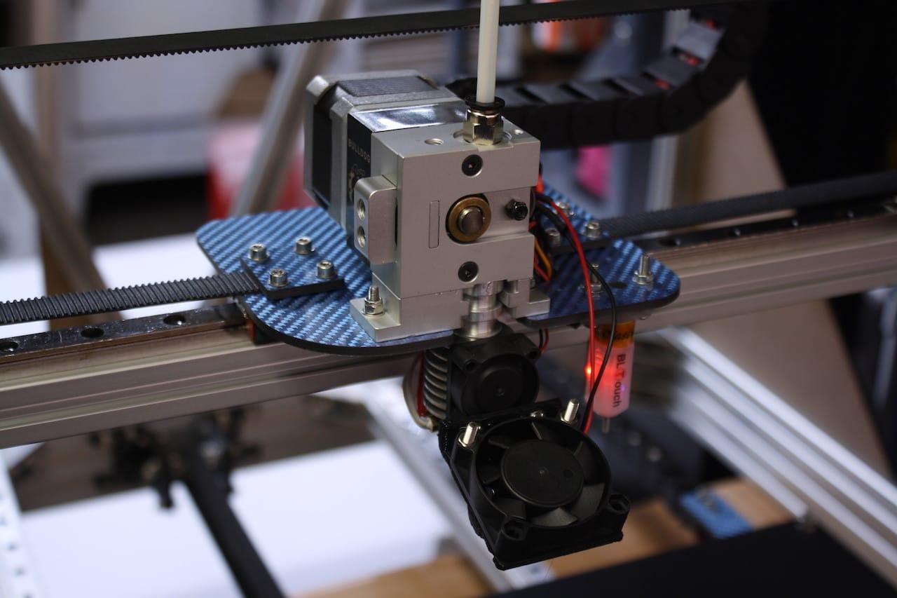 The extruder on Filament Innovation's BP475 desktop 3D printer, showing some carbon fiber components