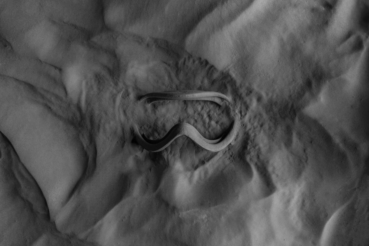3D printed ski goggles on the new Formlabs Fuse 1 showing how the final object is embedded in a powder bed