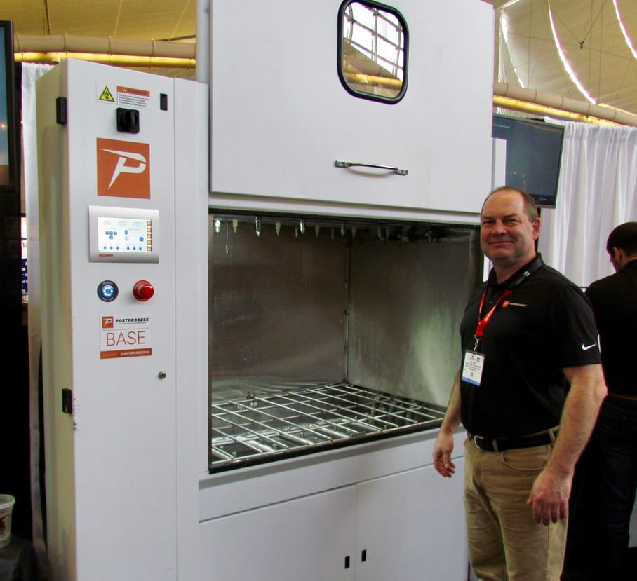 Showing the enormous size of the PostProcess BASE 3D print cleaning station