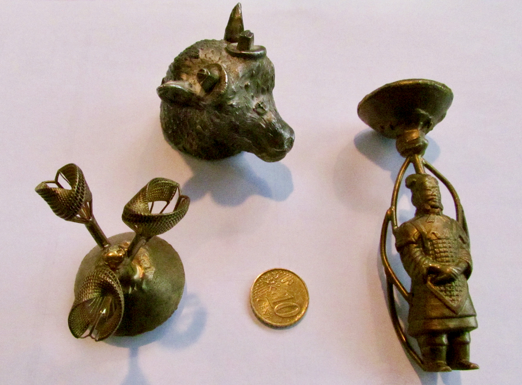 Sample 3D prints from the Nyomo Minny that have been cast into metal