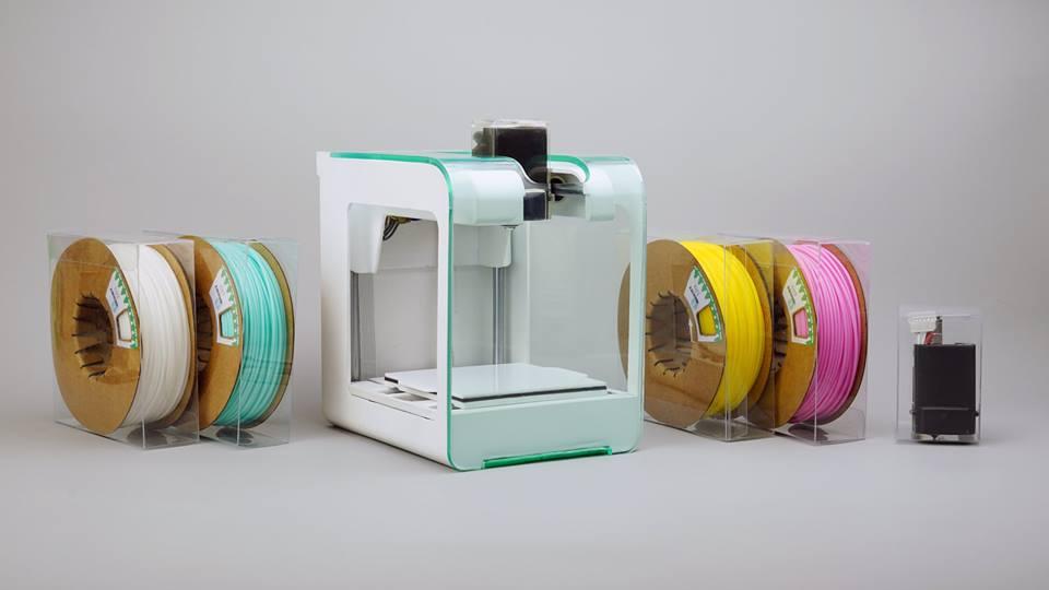 The PocketMaker desktop 3D printer with associated tiny spools of filament