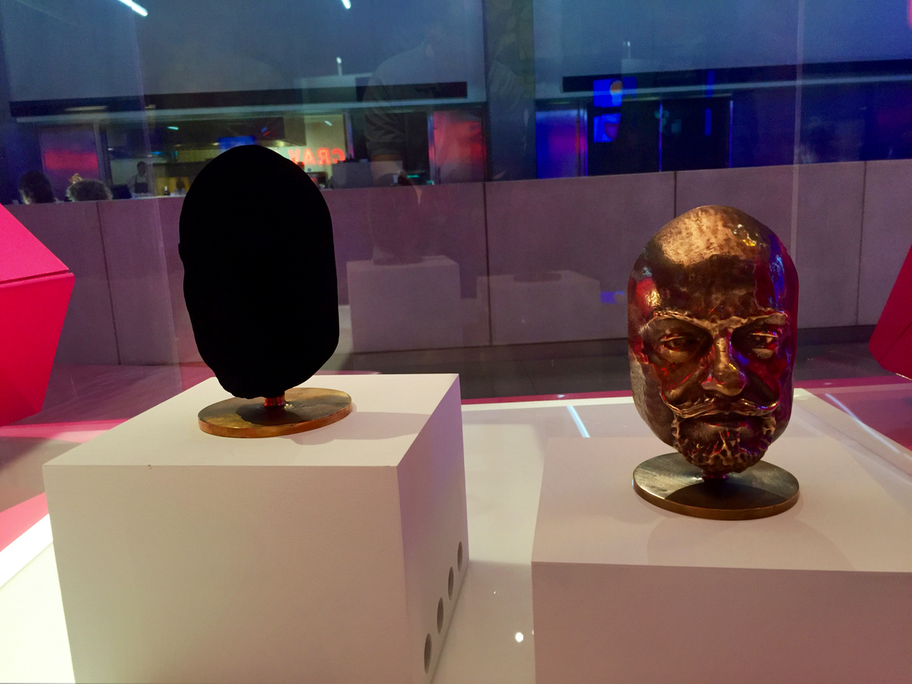 Two identical metal sculptures, one coated with Vantablack, the world's darkest material