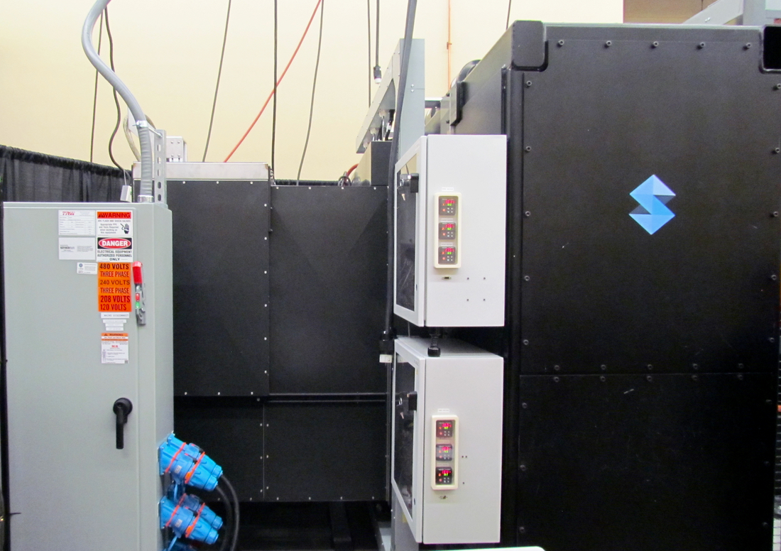 The rear section of the Stratasys Infinite Build 3D Demonstrator, where prints will emerge (from right to left in this image)