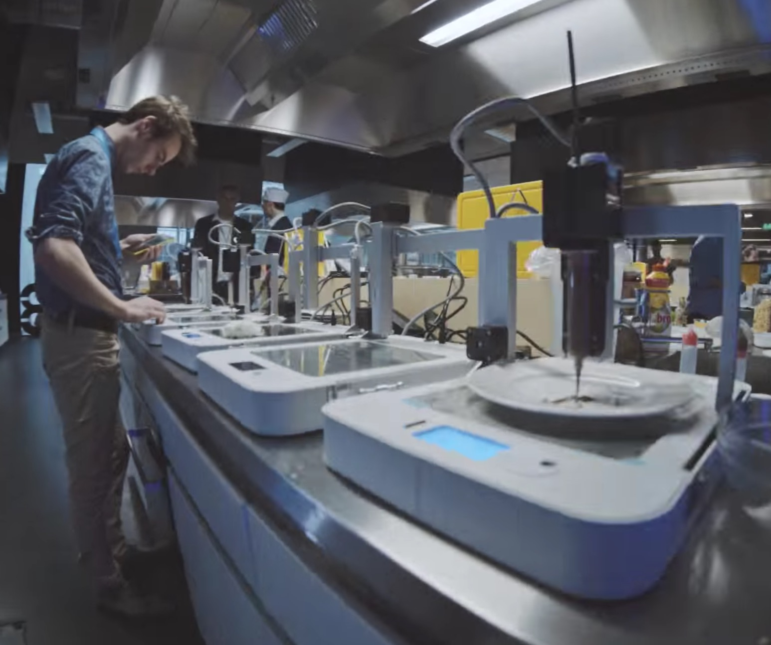 An array of 3D food printers in operation