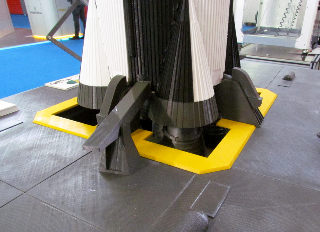 The base of the Saturn V Rocket 3D print where lockdowns hold the vehicle as it gets up to speed