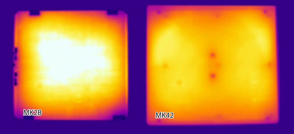 An infrared view of a heated 3D print bed with cold corners (left) and the improved i3 MK2 bed