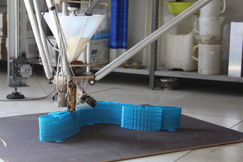 The Delta Wasp Pellet 3D printer producing a full-size chair