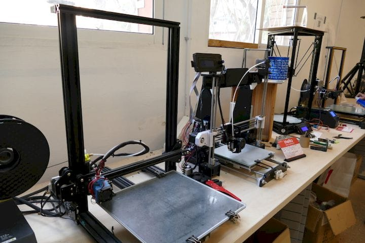 Bunches of 3D printers at MADE, just as you would hope to find in a makerspace.