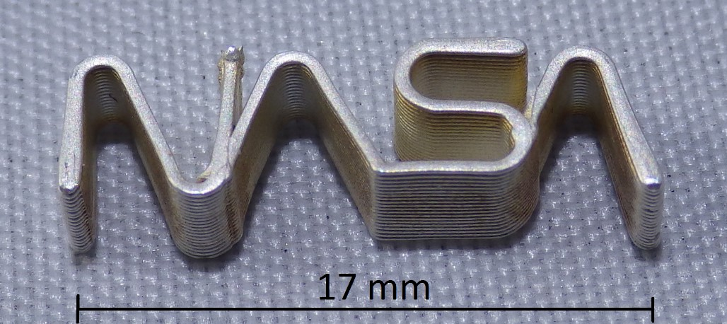 Printed silver NASA logo with 0.5 mm wall thickness from 2011 [Image: nScrypt]