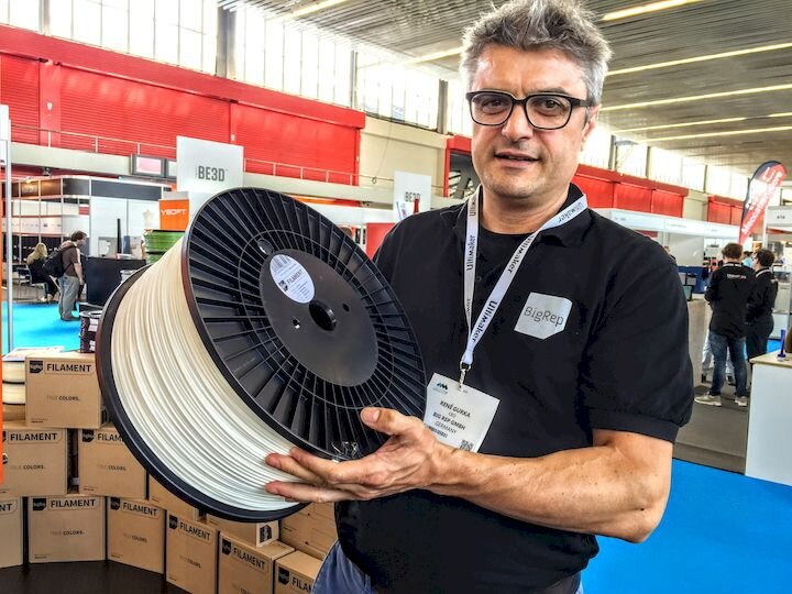 BigRep founder, the late René Gurka, showing off some huge filament spools [Source: Fabbaloo]