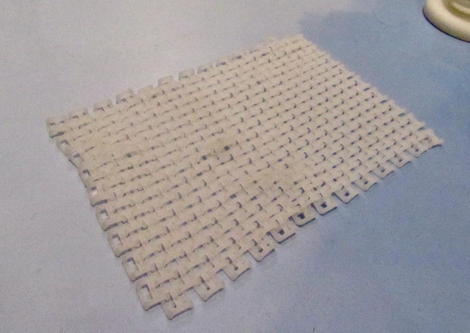 An interlocking mesh made of nylon, printed on the Ricoh AM 5500SP SLS 3D printer