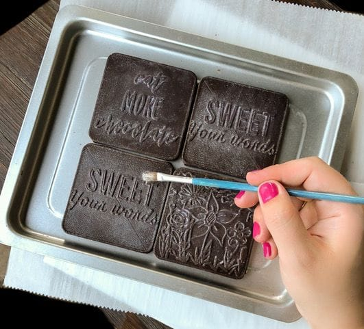 Finishing up producing custom-made chocolates using 3D tech
